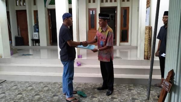 Pemerintah Desa Caturtunggal Serahkan Akta Kematian Program Lukadesi Di Padukuhan Nologaten